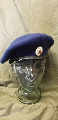 Blue Beret + Badge.