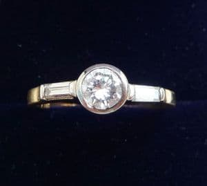 Beautiful 18ct and white gold 0.65ct Diamond solitaire and baguette cut engagement vintage ring