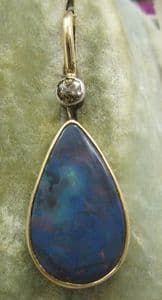 Large natural full Black Opal pear shaped pendant with diamond top 14ct gold