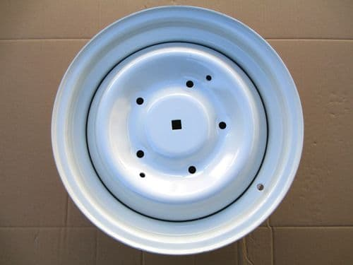Wheel, 5.5J x 15 with square centre hole. NEW part, not refurbished.