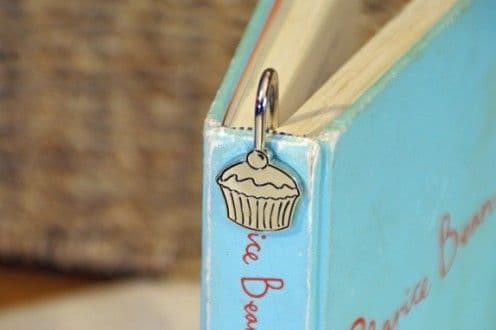 CUPCAKE stainless steel bookmark fits down the spine of the book. Comes in attractive box